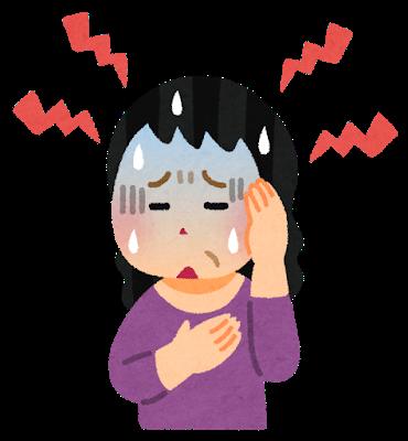 頭痛、動悸に襲われている女性